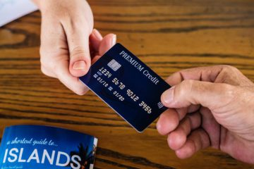 two hands changing credit card